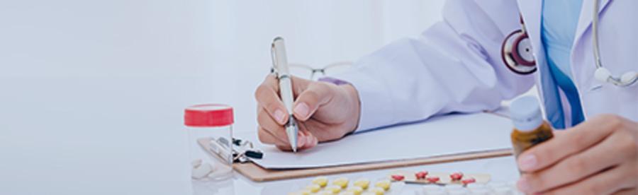 Doctor writing a prescription